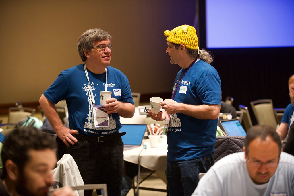 two mentors talking during DrupalCon contribution day, 2019.