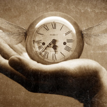 A hand, holding a clock with wings. Holding on to elusive time.